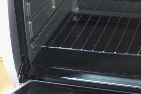 Open electric oven, empty, in a kitchen