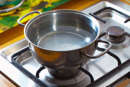 Pot full of water over cooking gas