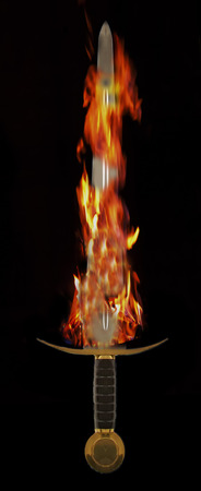 Long medieval metal sword, covered by flames Stock Photo