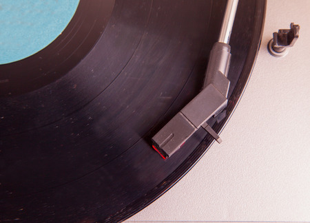 Turntable seen from above, record with blue label