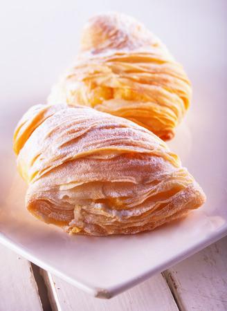 Sfogliatelle, typical Italian pastries, over white plate Stock Photo