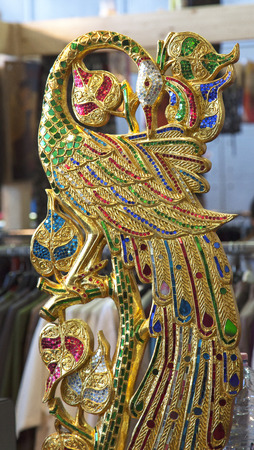 disciplines: TURIN, MARCH 27, 2015: Golden decoration in shape of bird at the Festival dellOriente, a great fair about oriental disciplines