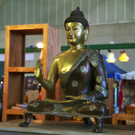 buddah: Buddah on metallic golden statue, sitting, square image Stock Photo