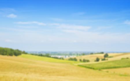 Fields on defocused background, horizontal image Stock Photo