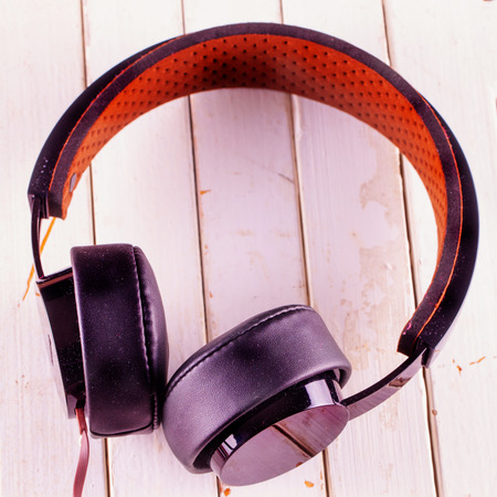 square image: Headphones over white wooden background, square image Stock Photo