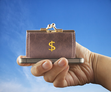 surmounted: Smartphone surmounted by purse with dollar symbol, horizontal image Stock Photo