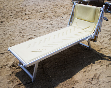 deckchair: Empty deckchair over sandy beach, horizontal image