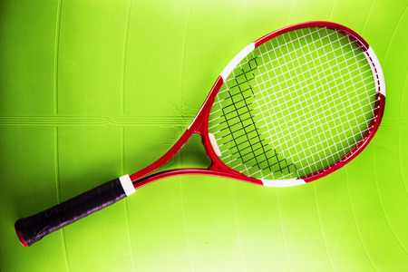 synthetic: Tennis racket over green synthetic surface