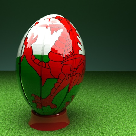 rugby field: Rugby ball with Wales flag over green grass field, 3d render, square image