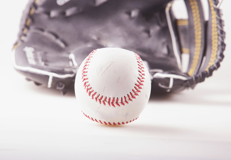 lacing: Baseball with glove on the back, white background
