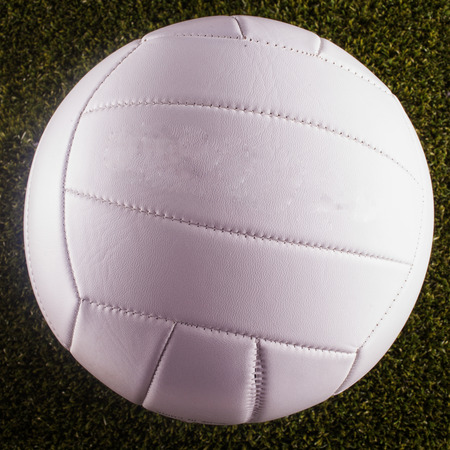 Volley: White Volley ball over grass, square image