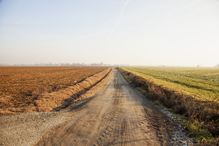 cutting through: Road cutting through the fields, horizontal image