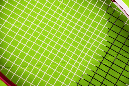 racket stadium: Tennis racket over green plastic field, close up, horizontal image