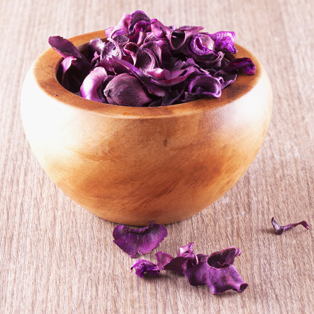 square image: Cup with pot pourri over wooden table, square image