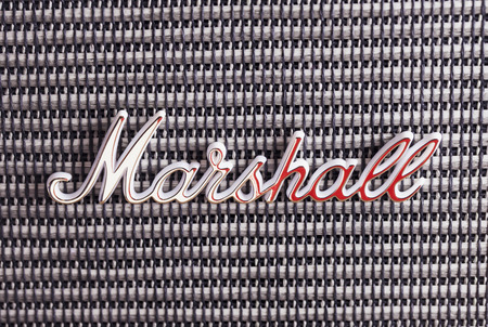 amplification: DECEMBER 12, 2015: Marshall Amplification logo over amp, close up. Marshall Amplification is one of leading worldwide brand in sound amplification and musical instruments.