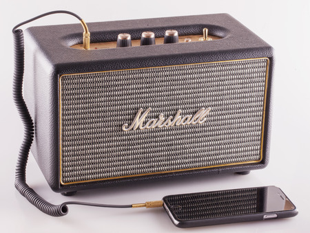 amplification: DECEMBER 12, 2015: Marshall amp linked to smartphone. Marshall Amplification is one of leading worldwide brand in sound amplification and musical instruments. Editorial