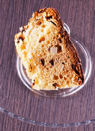 vertical image: Panettone slice over glass stand, vertical image Stock Photo