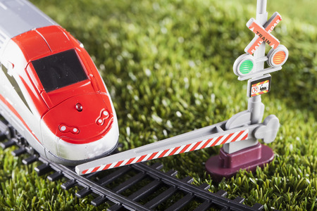stopped: Toy train stopped by bar, horizontal image
