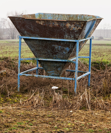 vertical image: Old and rusty cement mixer, vertical image