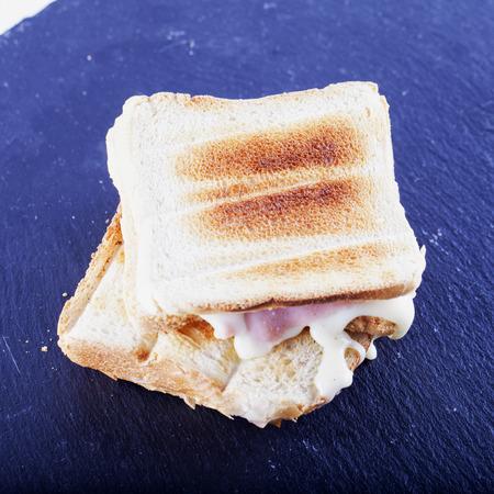 square image: Toast over black stone plate, square image Stock Photo