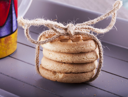 bounded: Biscuits bounded over tray, near a cup, horizontal image Stock Photo