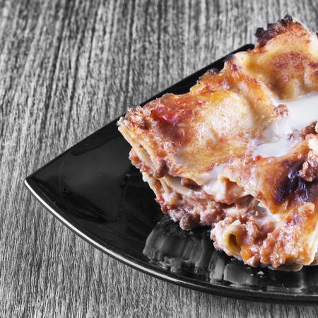 square image: Lasagna over black and white background, square image Stock Photo