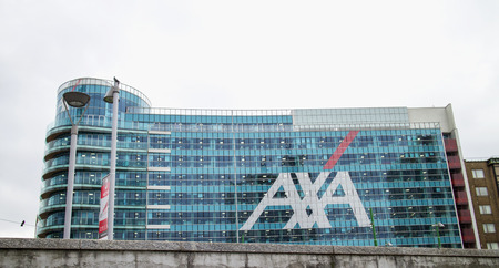 urban redevelopment: MILAN, ITALY - MARCH 30, 2016: Axa Palace in Milan. Futuristic building was build in the Porta Nuova urban redevelopment project in 2014. Axa is one of premiere brand of insurance in Italy.