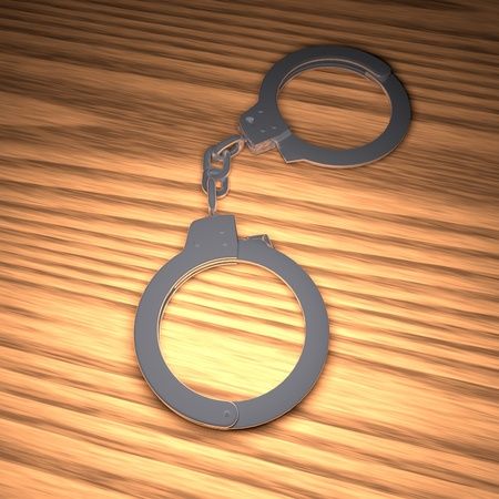 metal handcuffs: Metal handcuffs over wooden table, 3d rendering Stock Photo