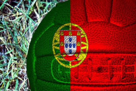 drapeau portugal: Portugal flag over vintage football, horizontal image Banque d'images