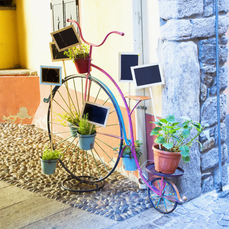 bycicle: Decorative old bycicle with blackboards and plants, square image