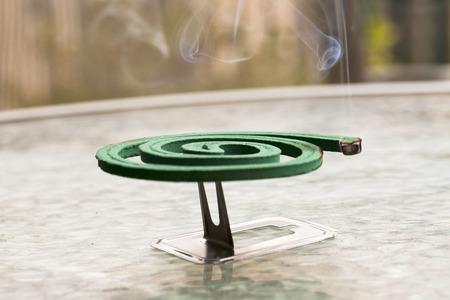 fumigador: Fumigator over glass table, close up, horizontal image