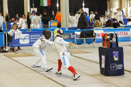 fencers: CASALE MONFERRATO, ITALY - FEBRUARY 25, 2017: Fencers in a match at Italian fencing Championships in Casale Monferrato