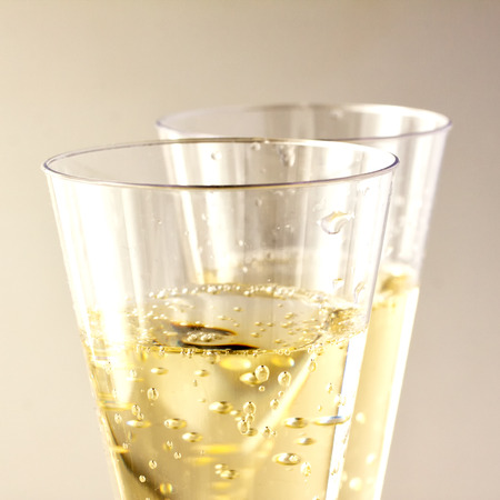 White wine glasses in strict close up over lite background, square image