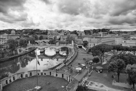 Black and white view of Rome under cloudy sky, horizontal image Stock Photo