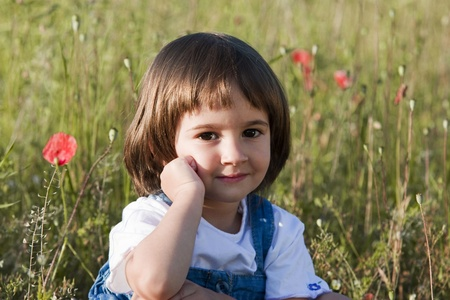 Little girl and poppies photo
