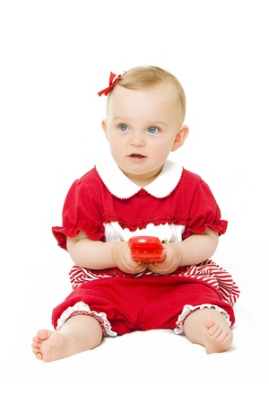 Baby girl in red with phone photo