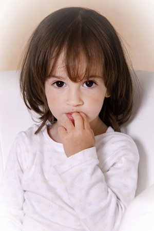 Little girl with finger in mouth