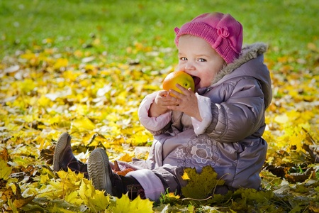 Cute baby with apple