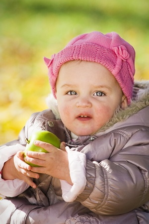 Cute baby with apple photo