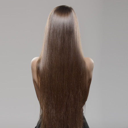 woman with long dark straight hair Stockfoto