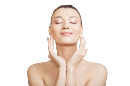 woman with clean skin touches her cheek with her hand. Perfect face skin concept on a white background.