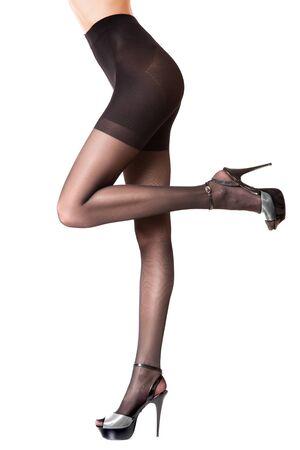 Slender female legs in tights. Womens long legs in hosiery