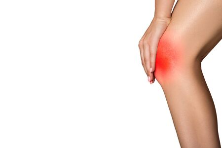 knee pain on a white background red spot. copycpase woman leg