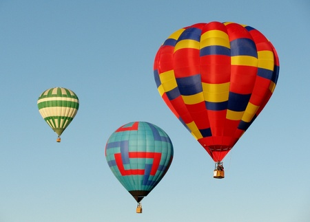 Three hot air balloons in blue sky photo