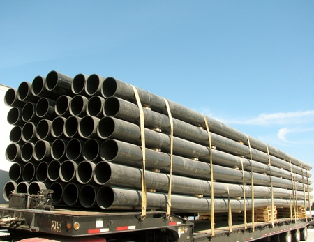 Load of black PVC pipes photo