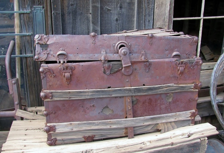sumptuous: Old chest  displayed on the side of a barn