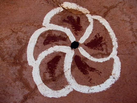 Flower painted on a rock wall. Primitive art. photo