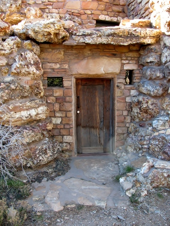 constructional: wooden door set in a stone wall Stock Photo