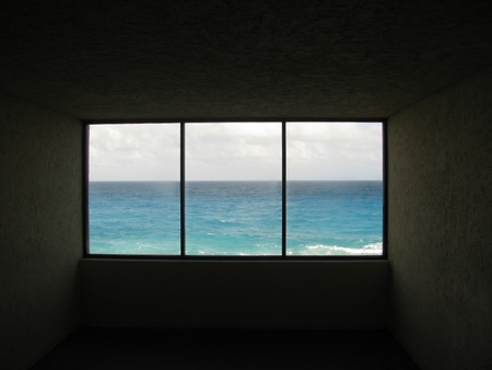 dark window sill and ocean