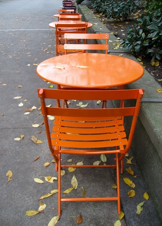 Empty tables in a street cafe photo